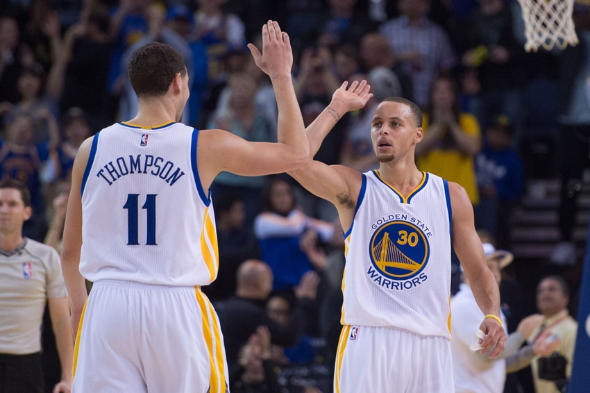 January 2, 2015; Oakland, CA, USA; Golden State Warriors guard Stephen Curry (30) celebrates with guard Klay Thompson (11) against the Toronto Raptors during the fourth quarter at Oracle Arena. The Warriors defeated the Raptors 126-105. Mandatory Credit: Kyle Terada-USA TODAY Sports