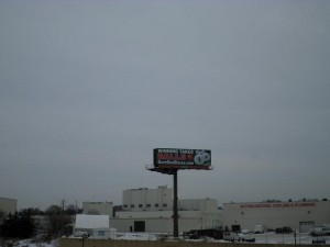Save Our Bucks Billboard from a distance